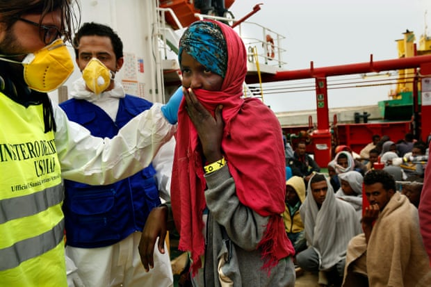 Eritrean refugees arrive in Sicily last November after being rescued from a smugglers' boat off the coast of Libya