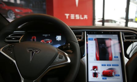 The inside of a Tesla vehicle is viewed as it sits parked in a new Tesla showroom and service center in Red Hook, Brooklyn on 5 July 2016 in New York City.