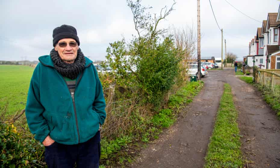 Local resident Mick Palmer in front of the site of the proposed lorry park.