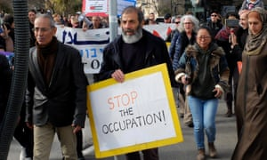 Pepe Goldman holds a 'Stop the occupation' sign at the Sheikh Jarrah protest.