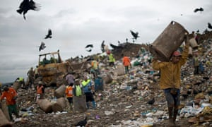 Catadores dig through waste at the Jardim Gramacho landfill in Rio de Janeiro in 2012 before it was permanently closed.