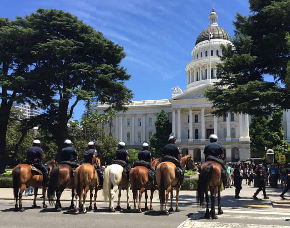 Sacramento mounted police keep watch over a protest in Sacramento in June 2016.