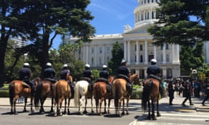 Sacramento police mounted officers prepare for crowd control at the rally.