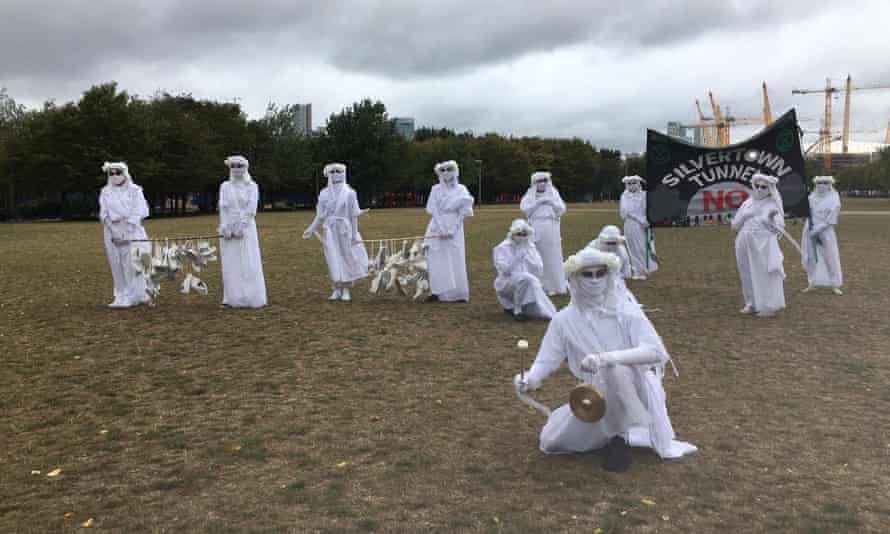 Extinction Rebellion activists don white for a secondary protest on the Greenwich peninsula.