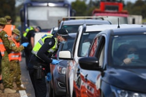 Victoria police and Australian defence force personnel at a roadside checkpoint near Donnybrook on Wednesday as police enforced a 'ring of steel'.