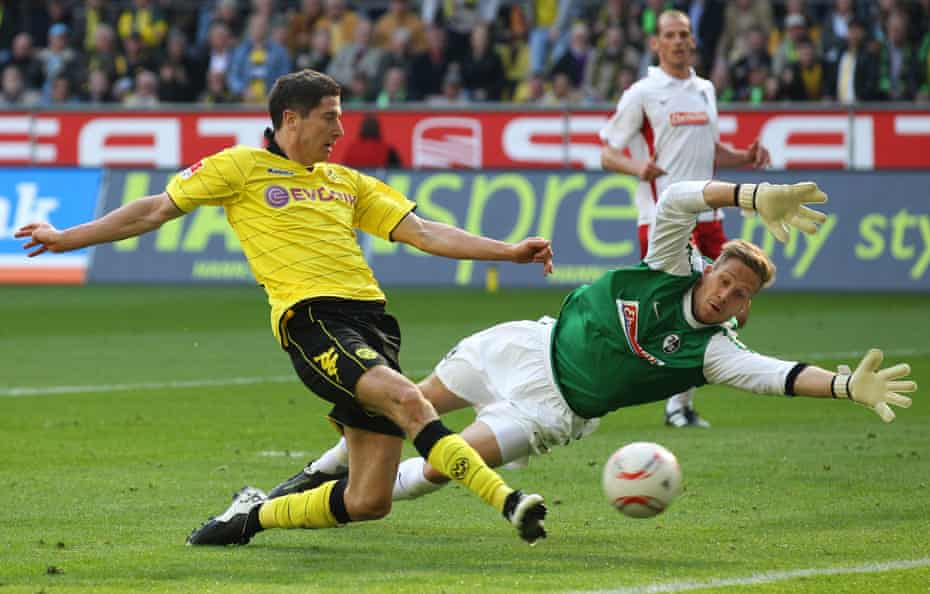 Robert Lewandowski, pictured scoring for Borussia Dortmund in 2011, used to bet coach Jürgen Klopp over how many goals he would score in training.