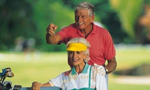 Elderly couple on golf course