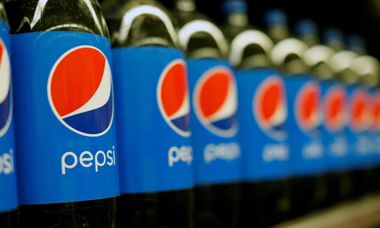 Row of Pepsi bottles on shelf
