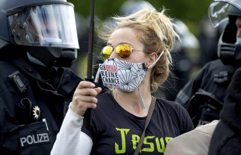 A woman wearing a face mask bearing the slogan 'Don't give (Bill) Gates a chance' during a demonstration against measures to prevent the spread of Covid-19 in Berlin.