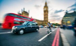 Traffic passes in motion blur on Westminster Bridge.