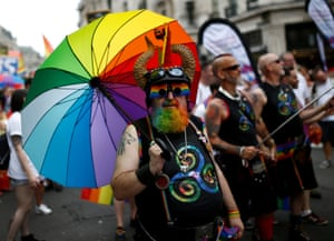 A rainbow-adorned reveller