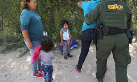 Border patrol agents take Central American asylum seekers into custody on 12 June 2018 near McAllen, Texas.