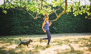 Genevieve and her miniature schnauzer Pepper having a run in the garden