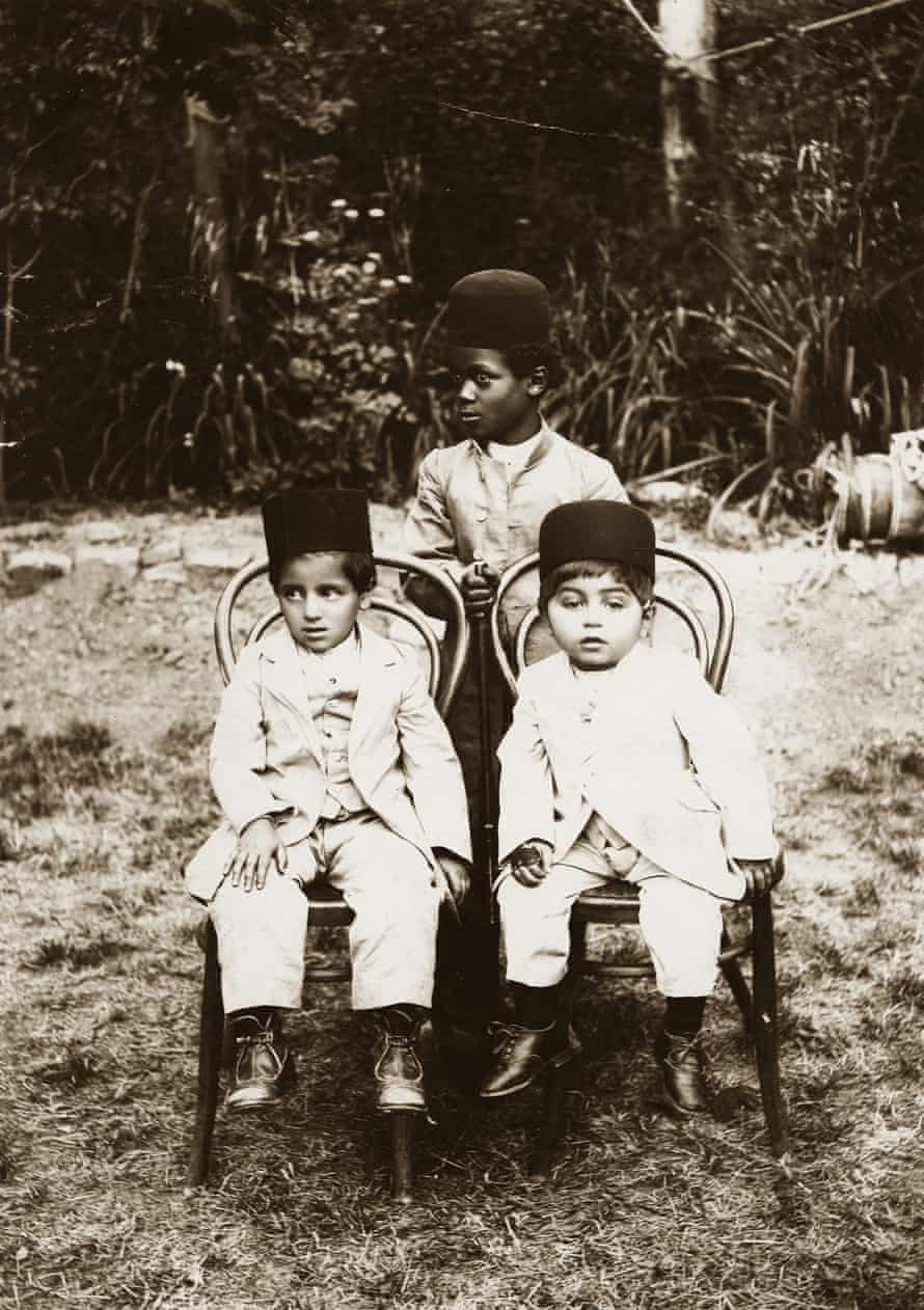 Qubad Il-khan Bakhtiari (right) and Hossein Il-khan Bakhtiari (left), sons of paramount Bakhtiar chief Il-khan Khosrow Zafar Bakhtiari, seated in a garden, probably in Isfahan, with their African slave, 1904. According to Khosronejad, this photo shows that slave ownership in Persia extended beyond the Qajar monarchy to tribal chiefs.
