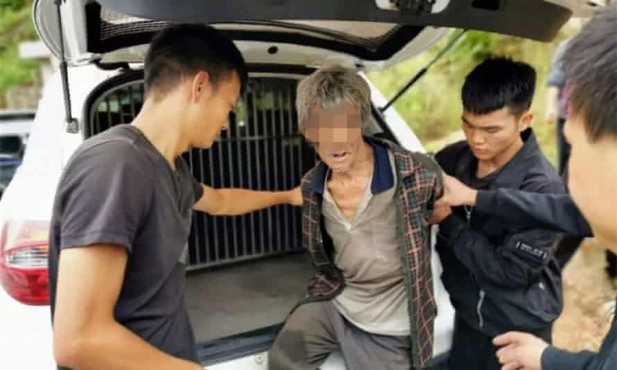 The 63-year old Song Moujiang, discovered by drone, being detained by Yongshan police.