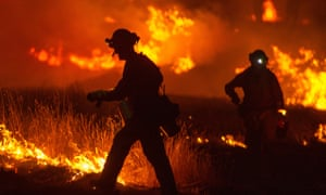A firefighter lights a backfire as the Rocky fire burns  near Clear Lake, California, on Monday night