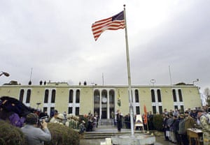 The American flag flies on a flag pole after it was raised at the opening ceremony of the US embassy in the Afghan capital of Kabul on 17 December 2001.