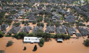 Homes are surrounded by floodwater after torrential rains pounded Southeast Texas following Hurricane and Tropical Storm Harvey on August 31, 2017 in Sugar Land, Texas.