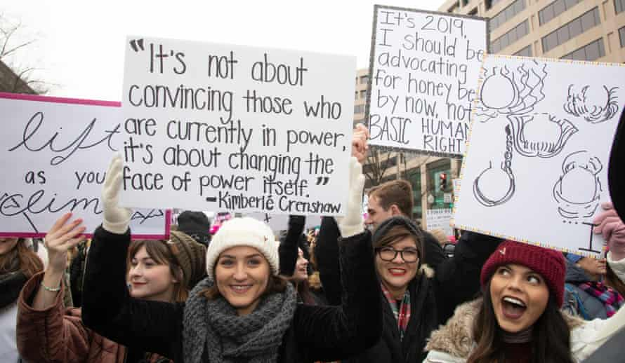An activist at the Women's March in Washington DC in January 2019 holds a placard bearing a quote by Kimberlé Crenshaw