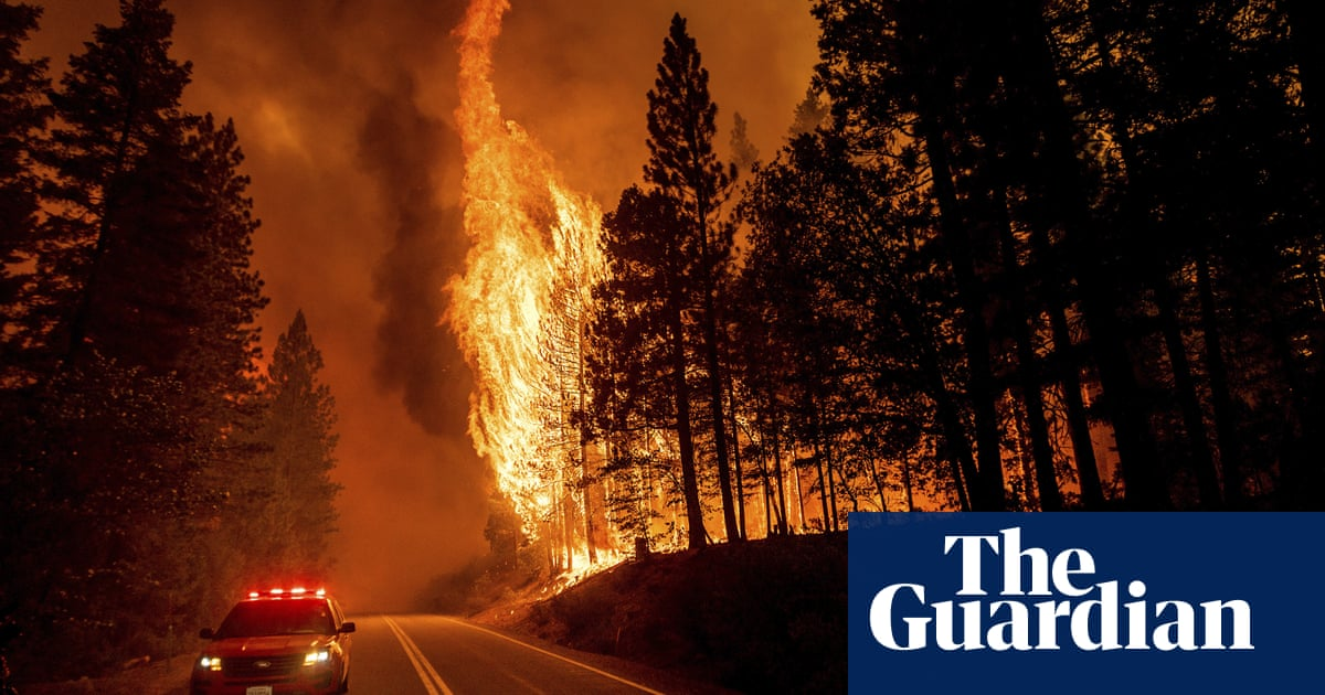 California's largest wildfire explodes as hot weather threatens new blazes