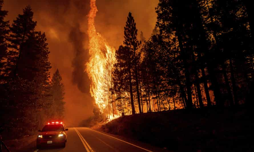 The Dixie fire jumps highway 89 north of Greenville in Plumas county, California, on 3 August.