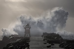 The large swell hitting the Newcastle breakwater