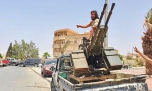 Libyan army recruits patrolling the city of Tarhunah.