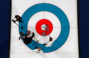 Married couple Anastasia Bryzgalova and Aleksandr Krushelnitckii, Olympic athletes from Russia, play Kristin Skaslien and Magnus Nedregotten of Norway in the curling mixed doubles bronze medal match.
