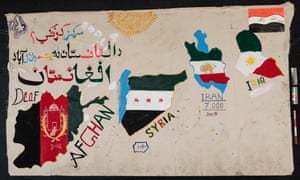 Road map … a canvas banner painted with the nations of a group of displaced people.