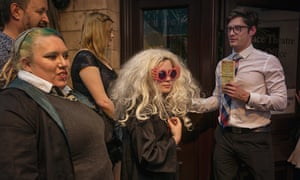 A woman dressed as character Luna Lovegood, centre, in the queue for the play.