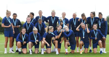 The Chelsea players pose with the Barclays FA Women's Super League trophy and their winners medals ahead of a training session in August.
