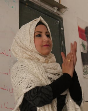 "Teacher Riham al-Hamoud: 'The children say: ""Should I tell you what happened in the siege?"" And I say: ""No, I'm not interested. Let's talk about nice things.""'"