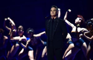 Robbie Williams performs songs from his new album on receiving a lifetime achievement award