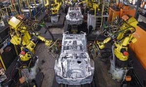 Robots weld vehicle panels at Nissan's Sunderland plant.