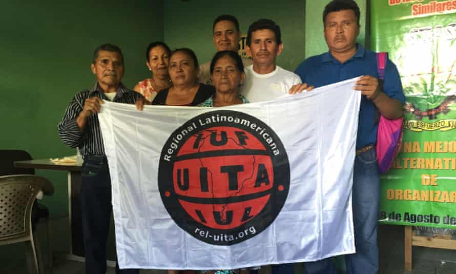Melon plantation workers with their union flag in Choluteca.