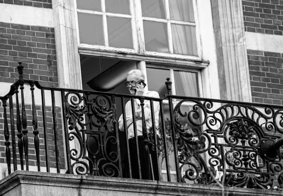 Labour leader Jeremy Corbyn talking on the phone outside his office