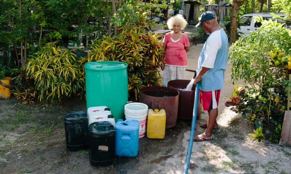 A vendor delivers water to locals in Gereka, Papua New Guinea