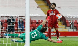 Crystal Palace keeper Wayne Hennessey saves from Liverpool's Mohamed Salah.