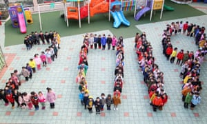 Children in in Changzhou, China, line up to form characters '2019' during a performance to welcome the new year.