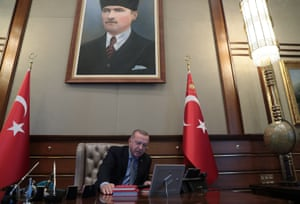 President Recep Tayyip Erdoğan speaks on video phone with the defence minister, Hulusi Akar, to give the order for an operation in Kurdish areas in morthern Syria, in Ankara, on Wednesday.