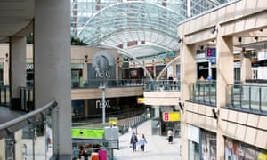 People walk through the Trinity shopping area of Leeds city centre.