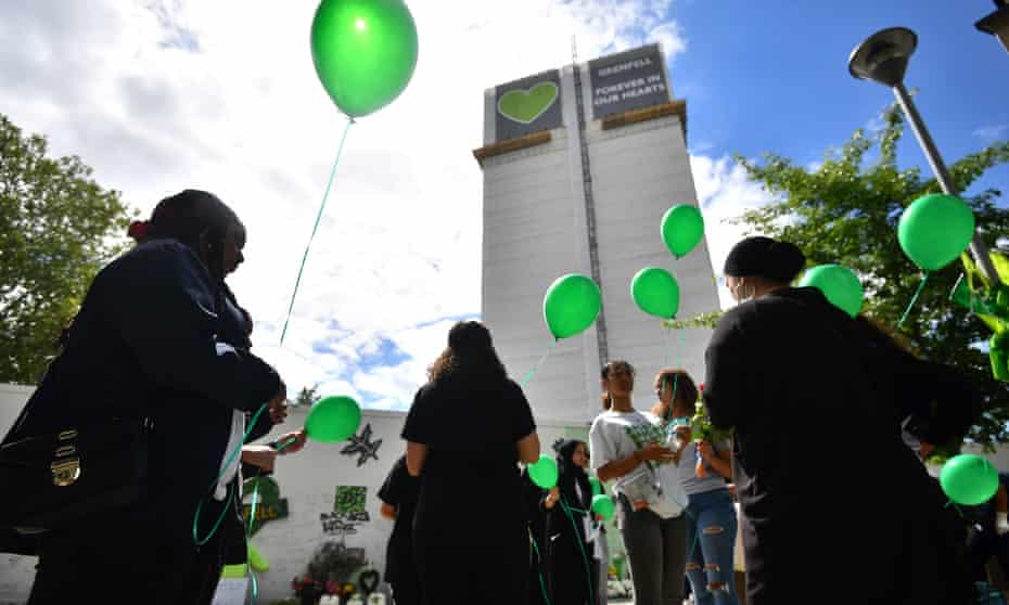 People release balloons at the Grenfell Memorial Community Mosaic