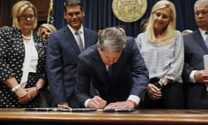 The Goergia governor, Brian Kemp, signs legislation banning abortions once a fetal heartbeat can be detected, which can be as early as six weeks before many women know they're pregnant.