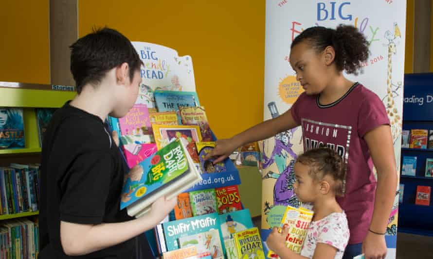 Children browsing through books at their local library