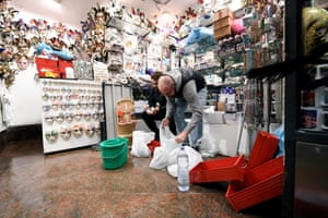 Shop owners remove damaged goods