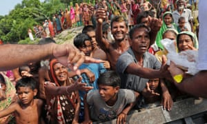 Flood-affected people gather to receive relief supplies in Jamalpur, Bangladesh