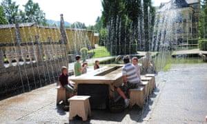 Visitors amid the fountains at Hellbrunn Palace, Salzburg, Austria.