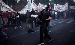 Demonstrator wearing a gas mask