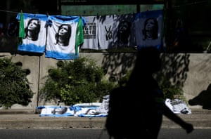 A demonstrator walks past shirts with the print depicting former Argentinian president Cristina Fernández de Kirchner, during a protest against the increase of public rates, in Buenos Aires, Argentina, on 13 February 2019