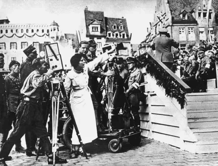 Riefenstahl (m), directing her film crew for her documentation of the Nazi Nuremberg party day in 1934.